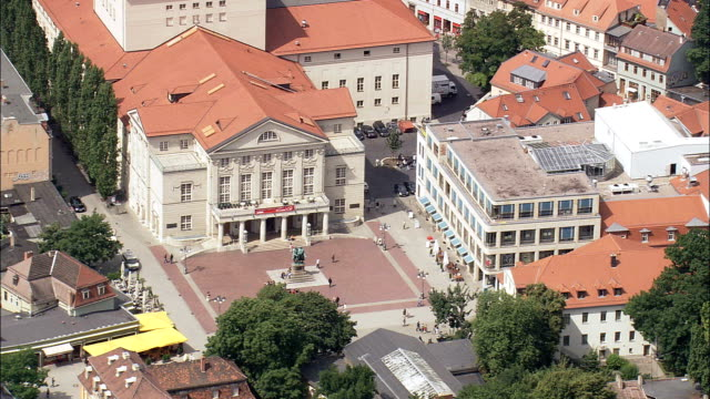 weimar national theatre  - aerial view - thuringia,  kreisfreie stadt weimar helicopter filming,  aerial video,  cineflex,  establishing shot,  germany - weimar stock videos & royalty-free footage