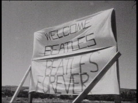 b/w 1964 welcome beatles beatles forever signs in wind / usa - the beatles stock videos & royalty-free footage