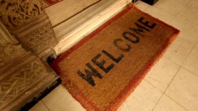 cu welcome mat at door to building/ cairo / egypt - welcome sign stock videos & royalty-free footage