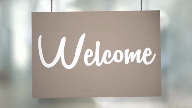 Welcome sign hanging from ropes. Luma matte included so you can put your own background.