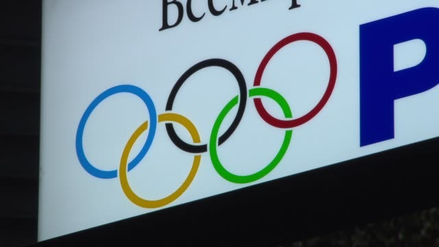 'welcome' sign in arrivals area of sochi airport / panasonic advertising with olympic rings logo russian writing / megafon billboard with advert for... - olympic rings stock videos & royalty-free footage