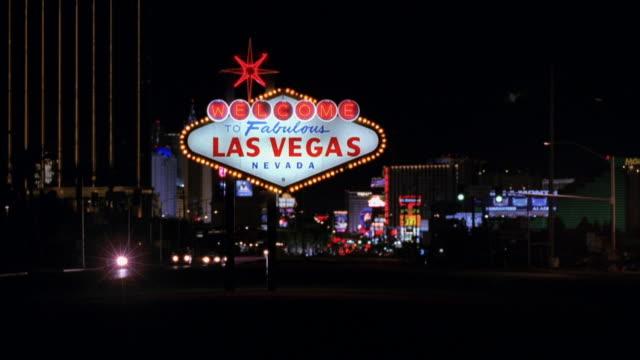 MS, Welcome sign on Las Vegas Boulevard at night, Las Vegas, Nevada, USA