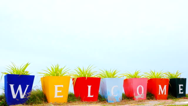 welcome sign on the flower pot - welcome sign stock videos & royalty-free footage