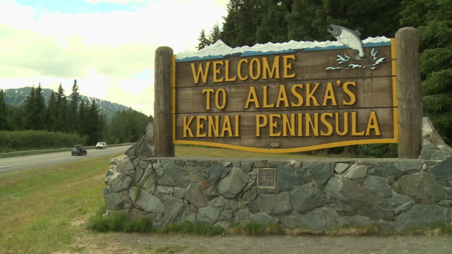 """welcome to alaska's kenai peninsula sign, located on the seward highway [visible left of shot], kenai peninsula, alaska."" - kenai stock videos & royalty-free footage"