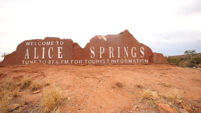 a 'welcome to alice springs' sign is seen on the side of the road approaching alice springs northern territory australia on february 6 2013 general... - northern territory australia stock videos & royalty-free footage