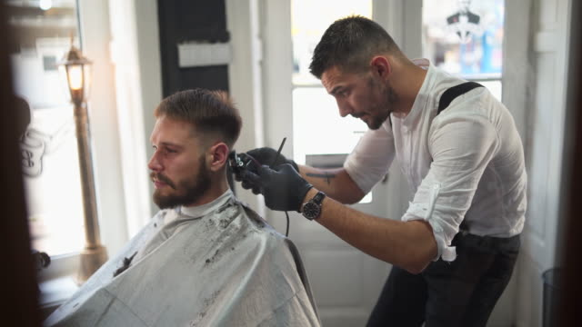 welcome to best barber shop in your town! - barber shop stock videos & royalty-free footage