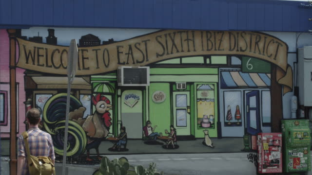 CU of Welcome to East Sixth IBIZ District mural on side of building in Austin