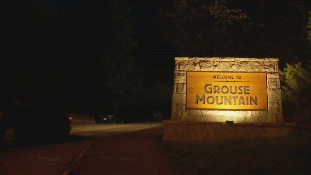 MS 'Welcome to Grouse Mountain' sign at night / Vancouver, British Columbia, Canada