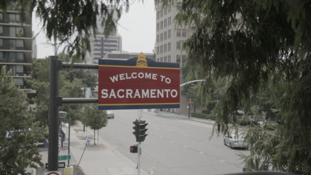 Welcome to Sacramento sign hangs above street