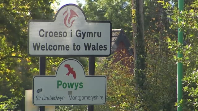 welcome to wales sign as wales announces travel ban into wales on people visiting from uk with highest rates of coronavirus infection - welcome sign stock videos & royalty-free footage