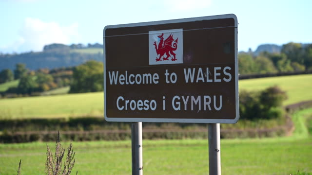 welcome to wales sign on october 15 in llangua, wales. the welsh first minister mark drakeford said that people from parts of england, scotland and... - road sign stock videos & royalty-free footage