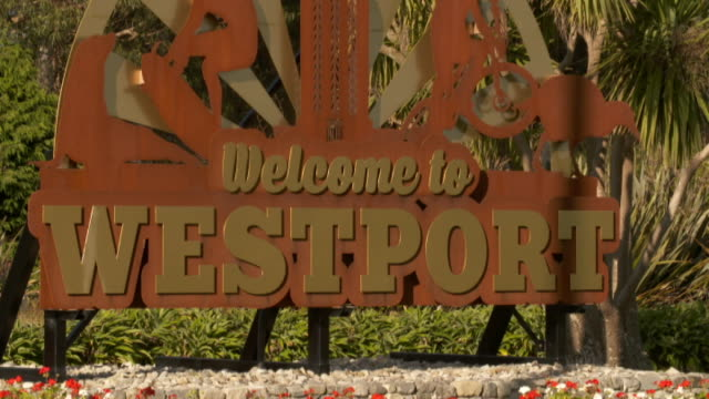 Welcome to Westport sign and railway crossing
