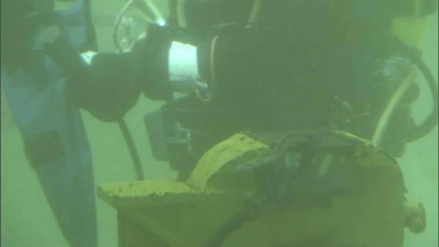 a welder assembles a tool underwater. - welder stock videos & royalty-free footage