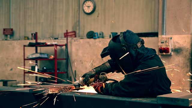 welder at work arc welder with welding sparks - welding helmet stock videos & royalty-free footage