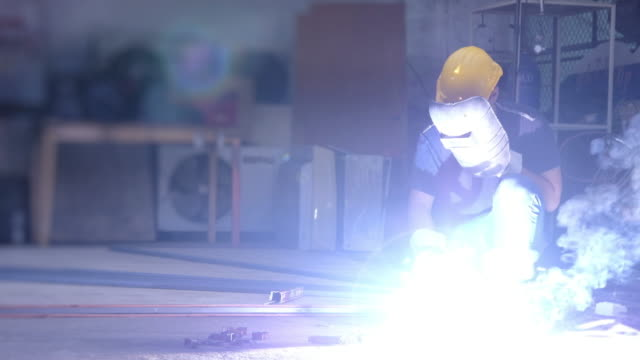 welder at work in factory and metal industry. - protection stock videos & royalty-free footage