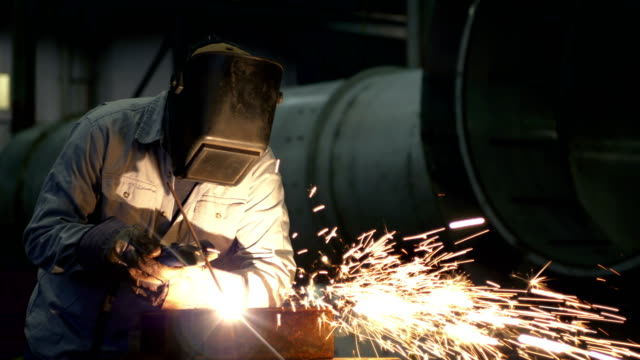 welder at work in metal fabrication shop - steel stock videos & royalty-free footage