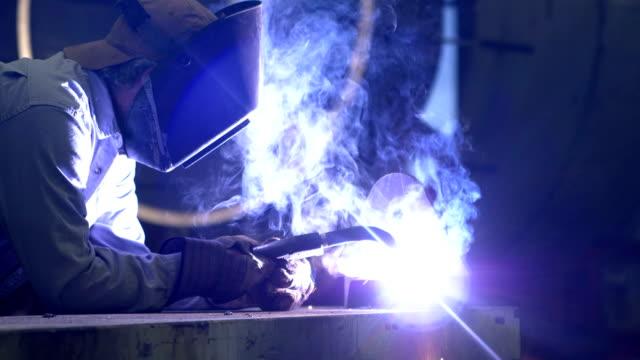 welder at work in metal fabrication shop - welding torch stock videos & royalty-free footage