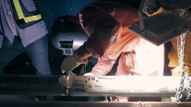 Welder at work of Gas tungsten arc welding (GTAW) in metal industry