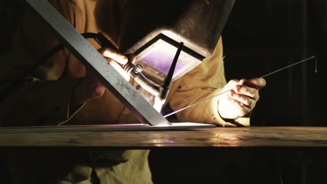 vídeos de stock, filmes e b-roll de ms tu welder at work / orem, utah, usa.  - orem utah