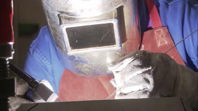 cu, welder at work - unknown gender stock videos and b-roll footage