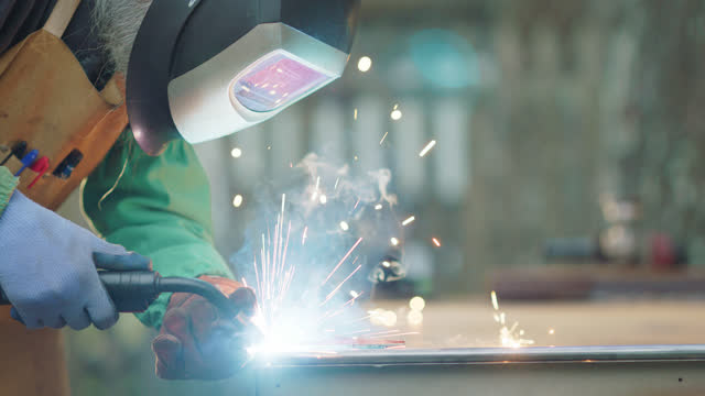 cu welder fabricates two steel pipes together - metalwork stock videos & royalty-free footage