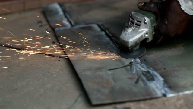cu welder grinding metal in workshop / delhi, india - only mature men stock videos & royalty-free footage