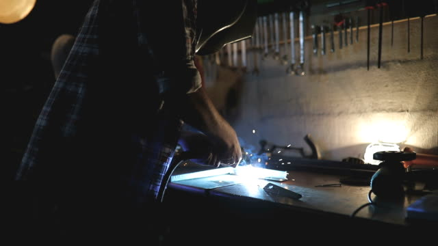 welder in a workshop - welding torch stock videos & royalty-free footage
