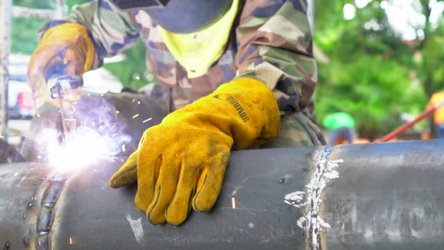 welder in slow motion - protective mask workwear stock videos and b-roll footage