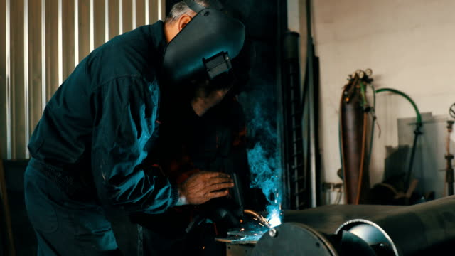 Welder in workshop 4K