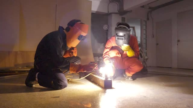 slo mo : welder in workshop - repairman stock videos & royalty-free footage