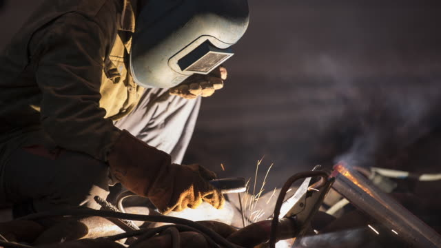 TS Welder repairing the links in a ship's anchor chain