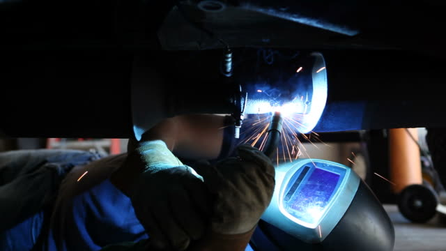 welder repairing truck exhaust - welding helmet stock videos & royalty-free footage