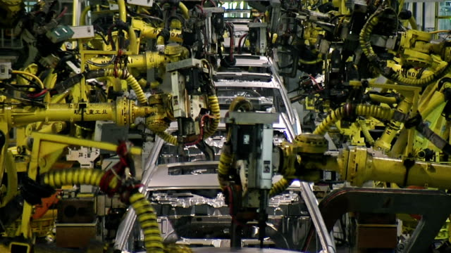 stockvideo's en b-roll-footage met welder robot - automobile industry