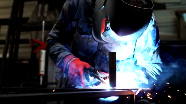 welder sparks flying at the camera - slow mo - welding torch stock videos & royalty-free footage