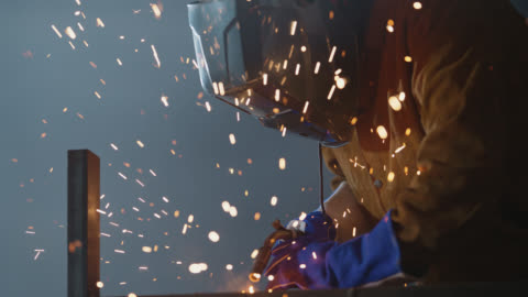slo mo cu welder wearing protective workwear uses welding torch - manual worker stock videos & royalty-free footage