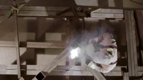 slo mo cs welder welding a metal frame - crane construction machinery stock videos & royalty-free footage