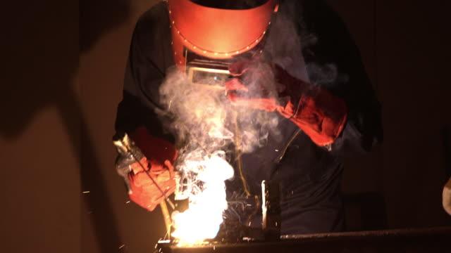 welder welding a metal in workshop - car plant stock videos & royalty-free footage