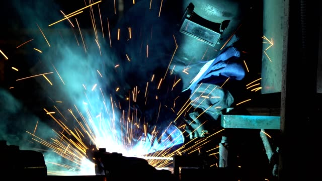 welder welding a metal in workshop - occupational safety and health stock videos & royalty-free footage