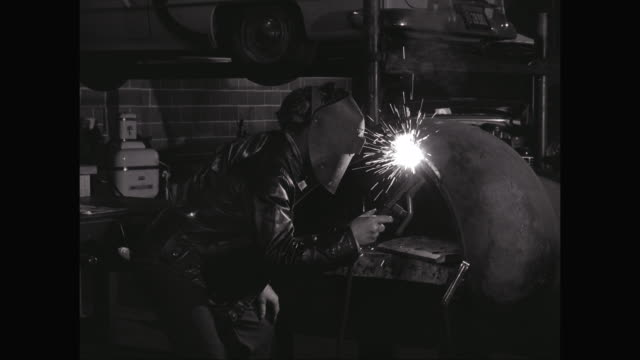 ms zi welder welding metal part of car in workshop / united states - metal industry stock videos and b-roll footage