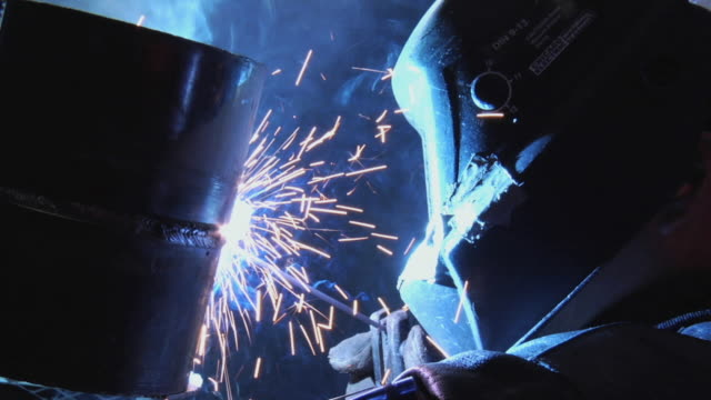 CU ZO Welder welding metal pipe / Chico, California, USA