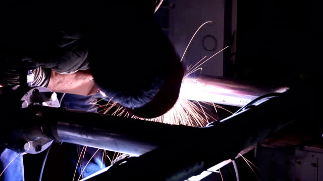 welder welding pipeline at night - orthographic symbol stock videos and b-roll footage