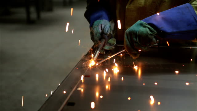 welder welds the details of the metal frame of the door. - ontario canada stock videos and b-roll footage