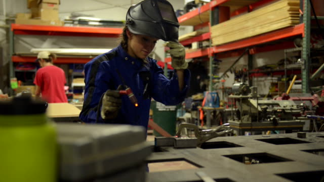 Welder worker girl - DOLLY SHOT