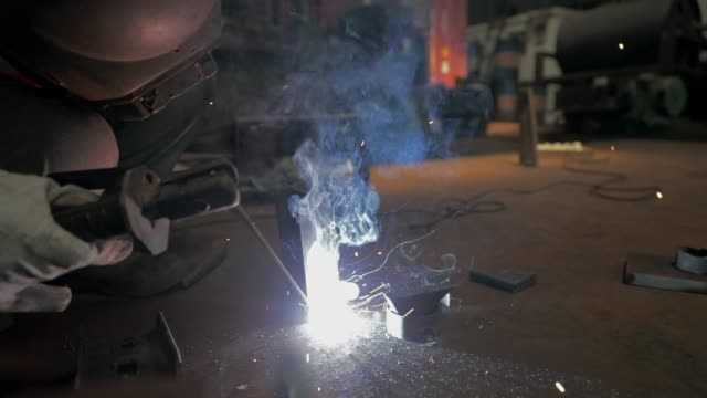 welder working at the steel factory in india - welding stock videos & royalty-free footage