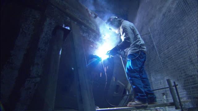 MS, LA, Welder working in tunnel, Mexico