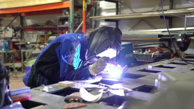 TIG welder working in workshop