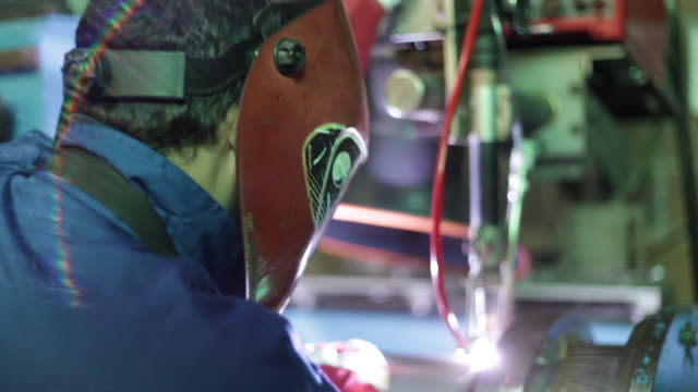 welder working with soldering iron - galicia stock videos & royalty-free footage