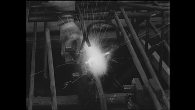 a welder works at a construction site on the tokaido shinkansen. - metal industry stock videos and b-roll footage