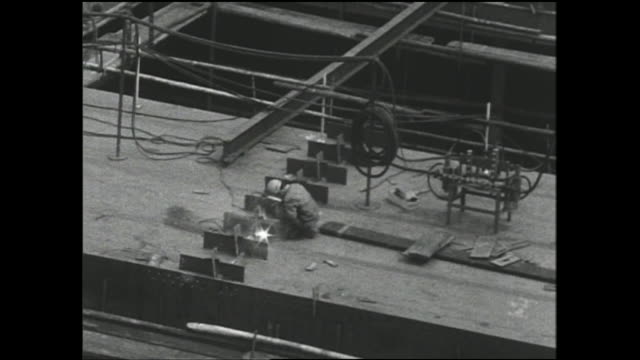 a welder works on the deck of a ship under construction in a shipyard at the port of osaka. - metal industry stock videos & royalty-free footage