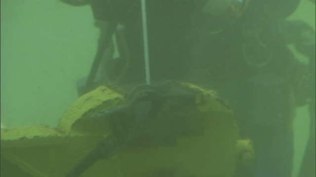 a welder works underwater. - underwater stock videos & royalty-free footage